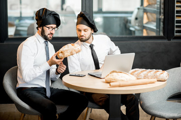 Bakers working with bread in the office