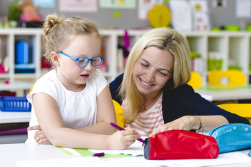 beautiful teacher helps her student to learn