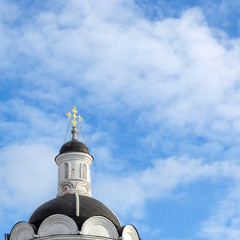 Orthodox christian cross on dome of Saint George's temple in Kolomenskoye, Moscow, Russia, beautiful Russian ancient orthodox church and religious landmark on bright sunny day with blue sky
