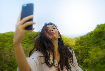 young beautiful and happy Asian Korean or Chinese tourist woman 20s in traditional dress taking selfie self portrait picture with internet mobile phone