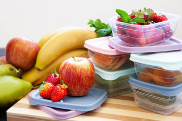 Filled plastic containers to save food and fruits fresh