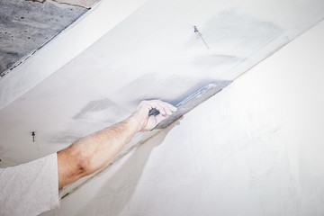 manual worker with wall plastering tools