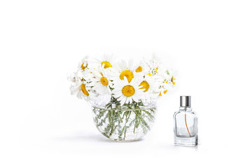 Bouquet of beautiful white daisy flowers in vase and Perfume bottle mock up, decorative wallpaper