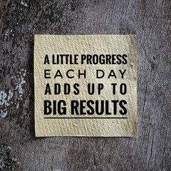 Motivational and inspirational quote - A little progress each day adds up to big results. With vintage styled background.