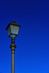 Old fashioned street lamp against blue sky (with copy space)