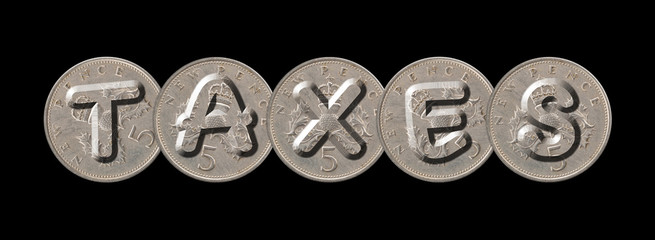 TAXES written with old British coins on black background