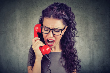 angry woman yelling on the phone