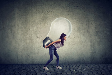 woman with business idea light bulb on her back