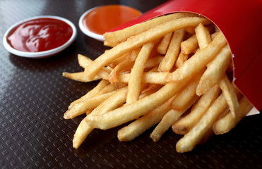 french fried in red box with ketchup and chilli sauce, junk food