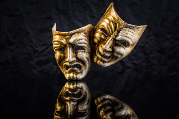 two theatrical masks are good and evil