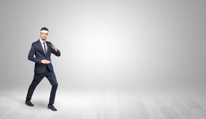 Young businessman in suit fighting in an empty space