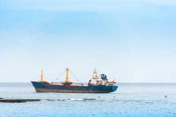 View of a cargo ship in the ocean, Bayahibe, La Altagracia, Dominican Republic. Copy space for text.