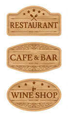 Wooden signboards with text scorched on wood. Design elements for outdoor advertising: bar, pub, cafe. Eps10 vector