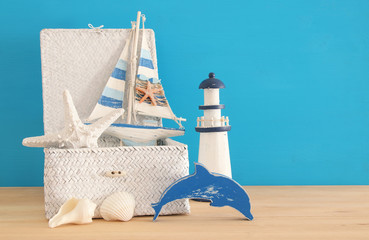 nautical, vacation and travel image with sea life style objects over wooden table.