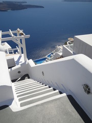 White and gray traditional stairs on Oia, Santorini Island, Greece