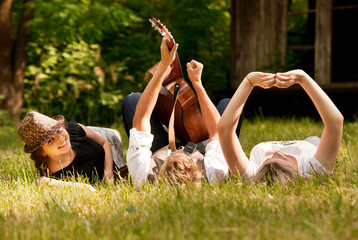 Carefree teenagers lying in grass