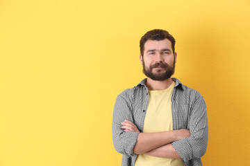 Portrait of confident mature man on color background
