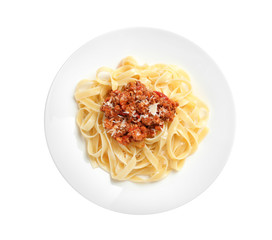 Plate with delicious pasta bolognese on white background, top view