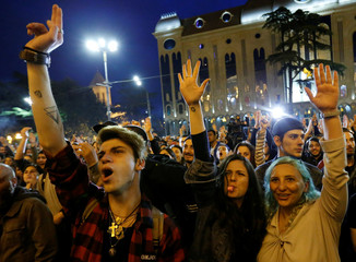 Protesters attend a rally against the Georgian authorities' anti-drug policy following the recent police raids at several local nightclubs in Tbilisi