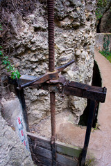 irrigation sluice system with rusty shutoff wheel in ronda, andalusia, spain