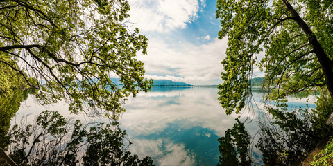 Beautiful Nature Scene Lake with trees touching the water