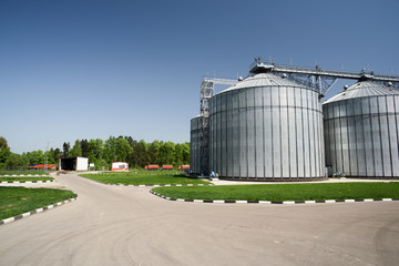 Modern animal feed factory granary. Big metal containers for grain