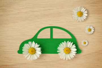 Paper car cut-out with daisy flowers - Eco-friendly car concept