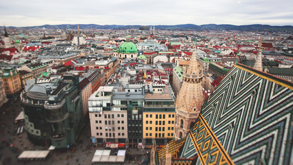 Beautiful super-wide angle aerial view of Vienna, Austria, with old town Historic Center and scenery beyond the city, shot from observation deck of Saint Stephens's Cathedral