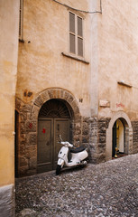 scooter standing at the empty street of old italian town