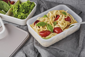 Pasta with roasted tomatoes and basil in lunchbox