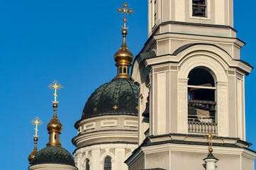 Domes of the Russian Orthodox Church and belfry. Close-up.