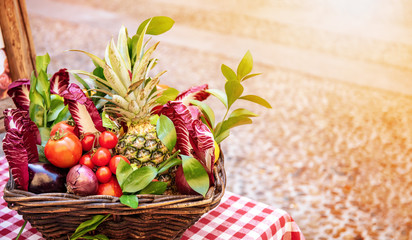 Basket of fruit and vegetables with copy space