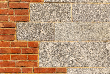 Background of granite and red brick wall combination