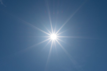 Sun and blue sky background