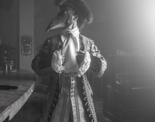 Actor in steam punk masks and antique costumes indoor. Black-white photo.
