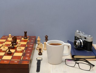 Postcard Father's Day. Father's things, a cup of coffee, chess pieces and the concept of love for parents.