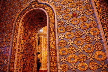 Baroque golden decorations on side chapel