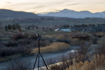 Camera on a tripod taking landcape pictures