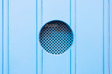 Leuca, Apulia - A traditional old metal peephole in a blue wooden door