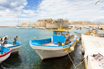 Gallipoli, Apulia - Fishing boat at the seaport in front of the town wall