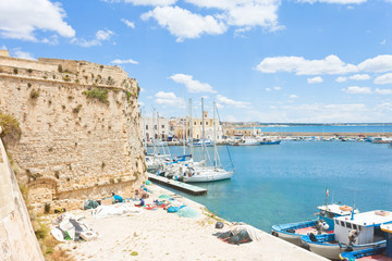 Gallipoli, Apulia - Sailing boats at the harbor near the historical city wall