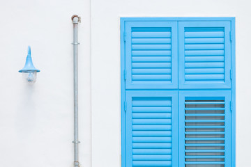 Gallipoli, Apulia - Design by a lantern, a rainwater pipe and a traditional window