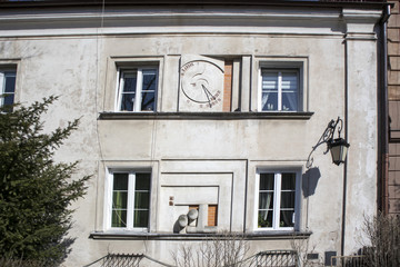 Ancient sundial on the external wall of building in Warsaw