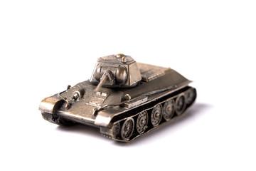 Iron toy tank. White background.