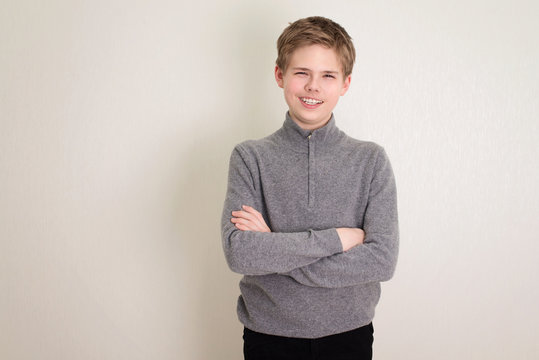 Confident teen boy portrait with arms crossed isolated.