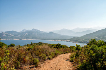 View of the clear sea and rocky hills in Corsica