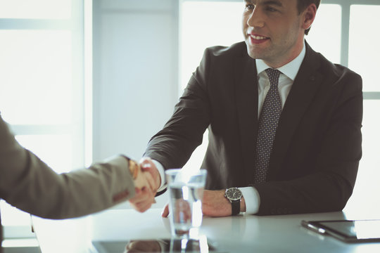 Portrait of businessman giving hand for handshake