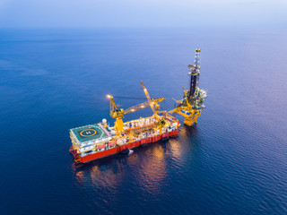 Wall Mural - Aerial View of Tender Drilling Oil Rig (Barge Oil Rig) in The Middle of The Ocean at Sunset Time