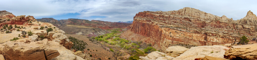 View of Fruita, Utah from the Cohab Canyon Trail. Fruita was an early Mormon settlement in the Capitol Reef area of south-central Utah. Red rock and sandstone cliffs dominate the environment.