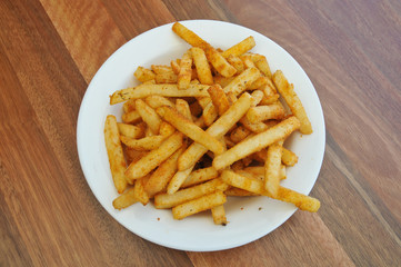 Spice golden french fries on a plate